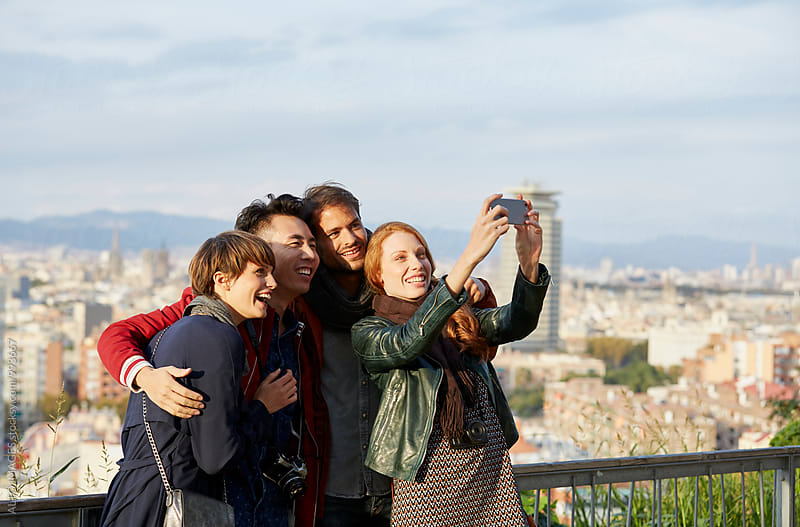 Happy Young Woman Taking Selfie With Friends by ALTO IMAGES for Stocksy United