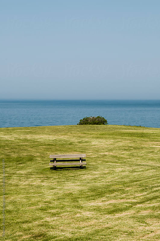 Table, chairs, grass and ocean, Hokkaido, Japan by Thomas Pickard for Stocksy United