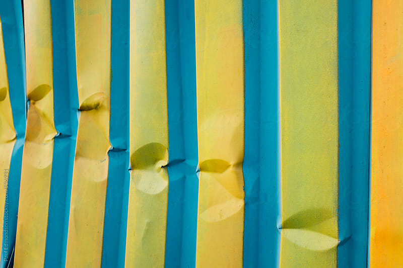 Brightly painted metal wall, close up by Paul Edmondson for Stocksy United