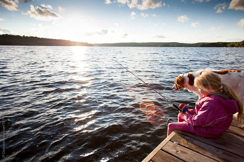 Little Girl Fishing From Dock on Lake at Cottage With Dog by JP Danko for Stocksy United