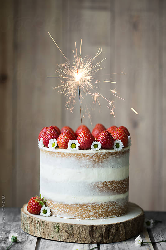 Strawberry celebration cake by Ruth Black for Stocksy United