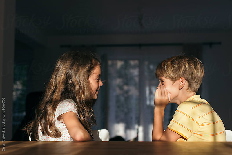Children talking to eachother. by Dejan Ristovski for Stocksy United
