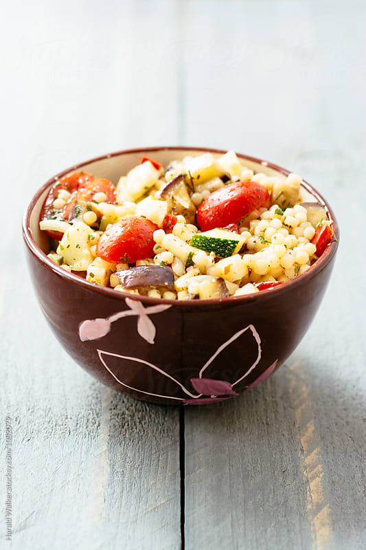 Ratatouille couscous salad by Harald Walker for Stocksy United