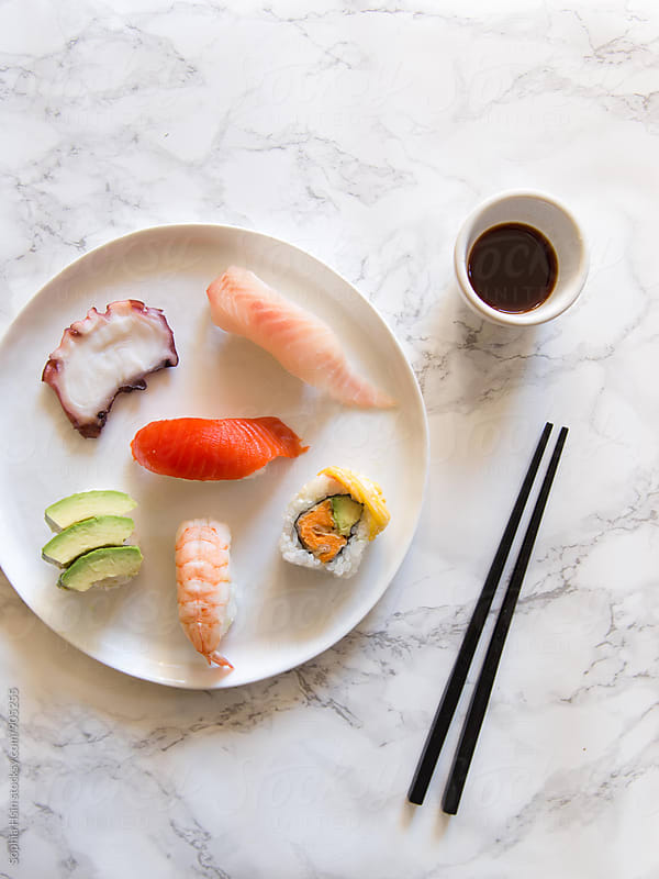Sushi plate on marble  by Sophia Hsin for Stocksy United