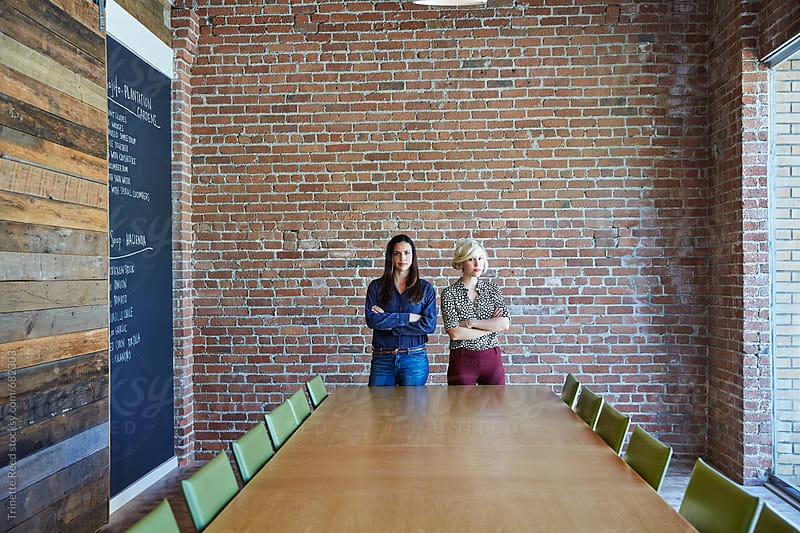 Portrait of two millennial businesswoman at tech start up office by Trinette Reed for Stocksy United