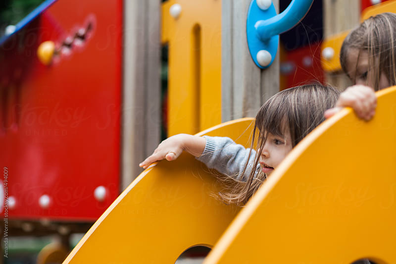 Girl gets ready to go down slide by Amanda Worrall for Stocksy United