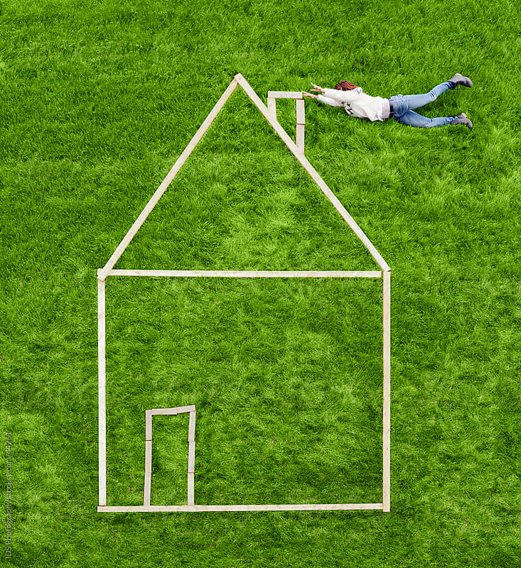 House on a grass. by IDS Photography for Stocksy United