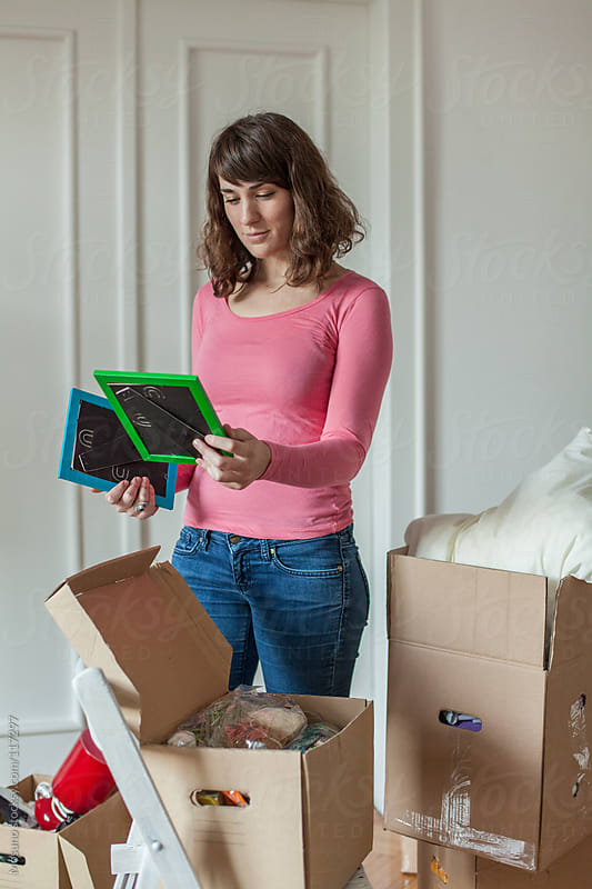 Young Woman Unpacking in Her New Home by Mosuno for Stocksy United
