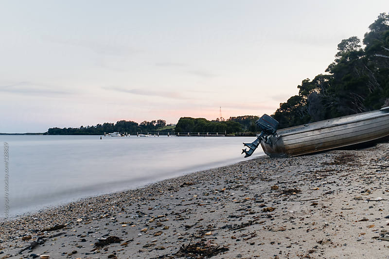 Hire Boat on Lake's Edge, Mallacoota, Victoria, Australia by Gary Radler Photography for Stocksy United