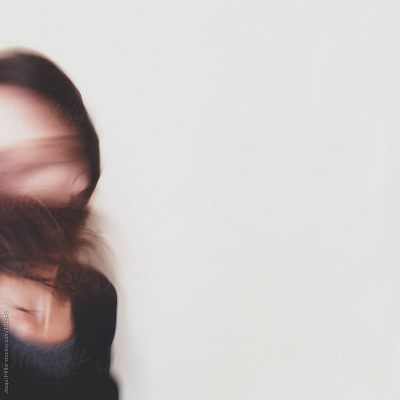 Movement shot of woman flicking her hair by Jacqui Miller for Stocksy United