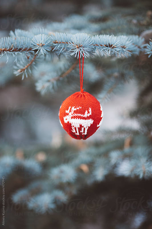 Red Christmas Ornament on a fir tree by Alexey Kuzma for Stocksy United