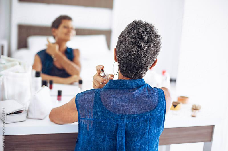Senior Woman Applying Perfume by Lumina for Stocksy United