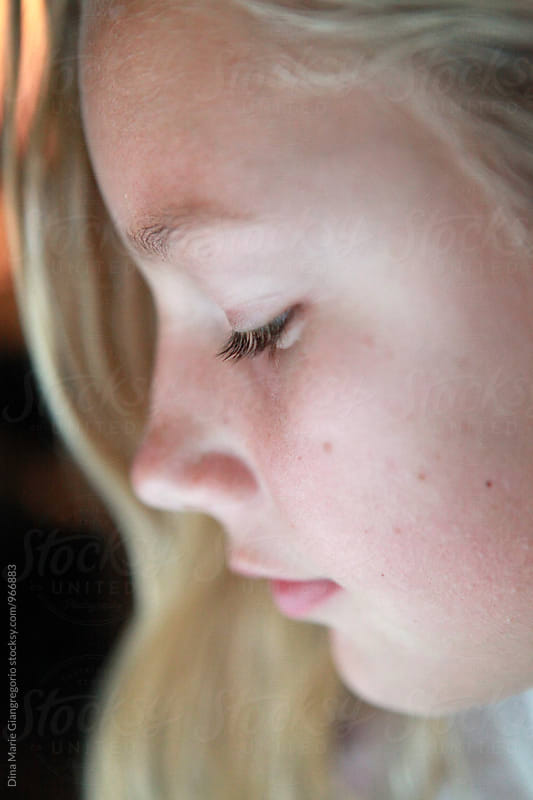 Close Up Side Profile Of Pretty Blonde Teen by Dina Giangregorio for Stocksy United