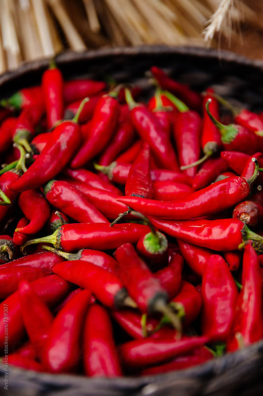 Closeup of red peppers by Andrey Pavlov for Stocksy United