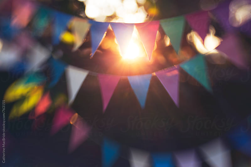 colourful paper bunting with bokeh... by Catherine MacBride for Stocksy United