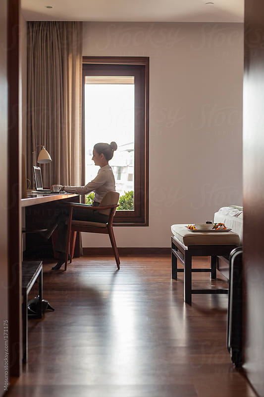 Woman Sitting in a Hotel Room by Mosuno for Stocksy United