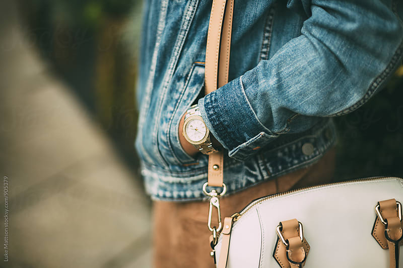 Close Up Of Watch And Purse On Shoulder Of Young Woman by Luke Mattson for Stocksy United
