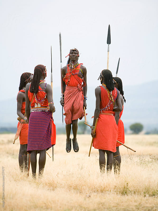 Maasai tribesman performing traditional dance. by Hugh Sitton for Stocksy United