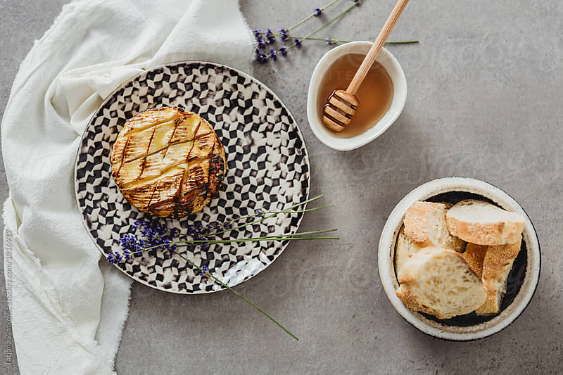 Baked camembert with honey and lavender by Tatjana Zlatkovic for Stocksy United