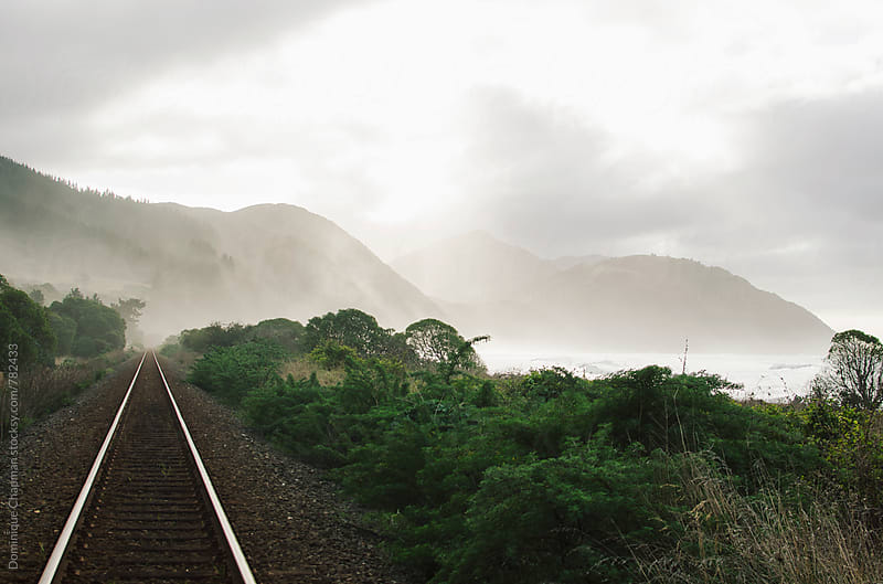 Railway leading to misty mountain by Dominique Chapman for Stocksy United