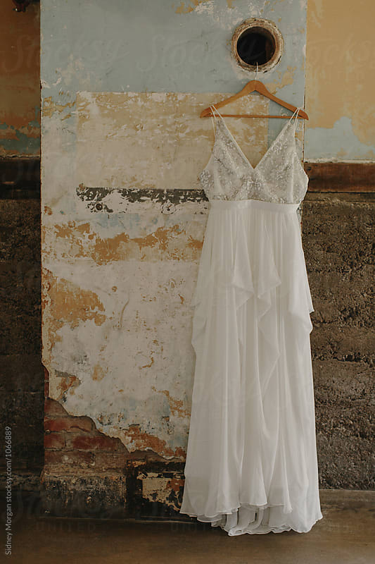 Wedding Dress Hanging on Wall by Sidney Morgan for Stocksy United