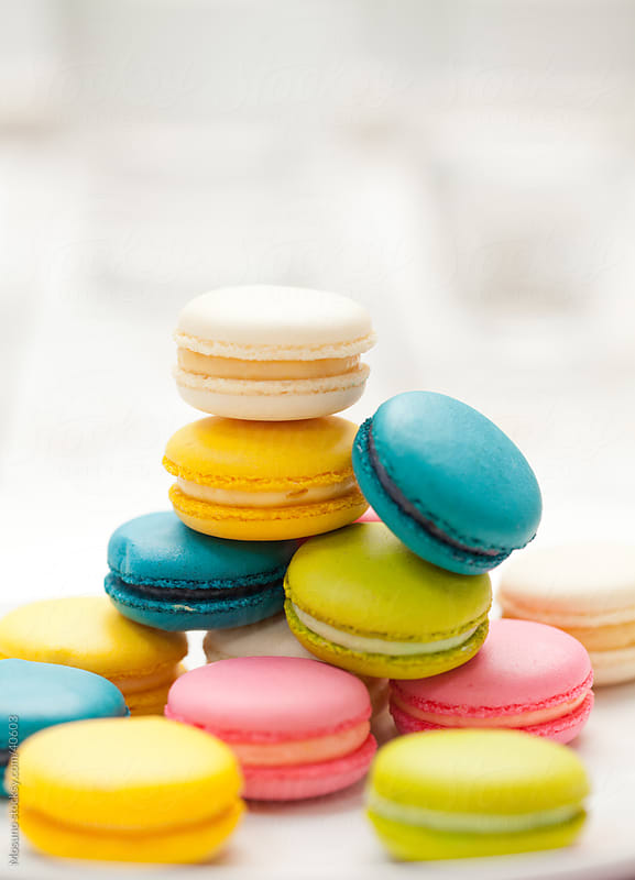 Colorful macaroons on a table. by Mosuno for Stocksy United