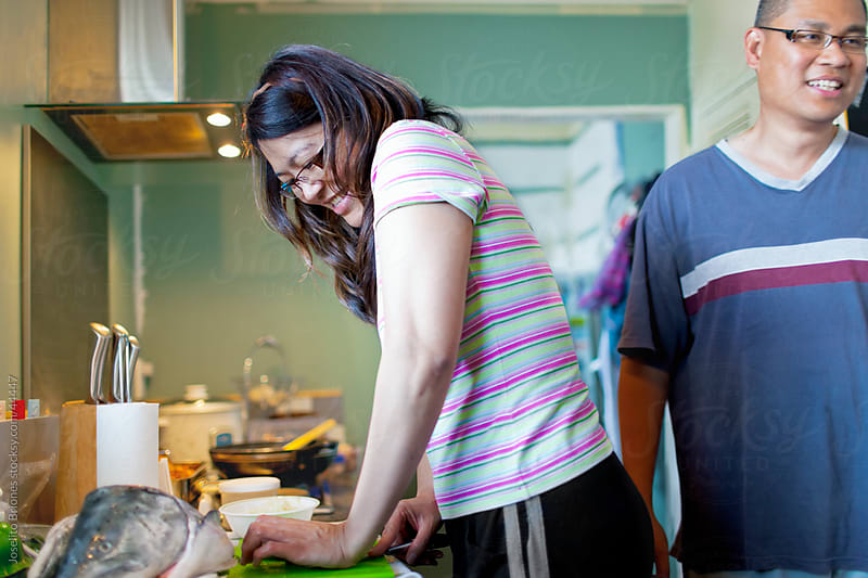 Husband and Wife Couple in Kitchen Cooking Together on Weekend by Joselito Briones for Stocksy United