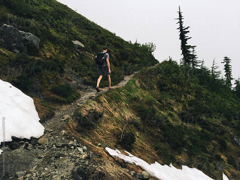 Male Hiker/Backpacker on an Alpine Trail through the Washington Cascade Mountains by michelle edmonds for Stocksy United