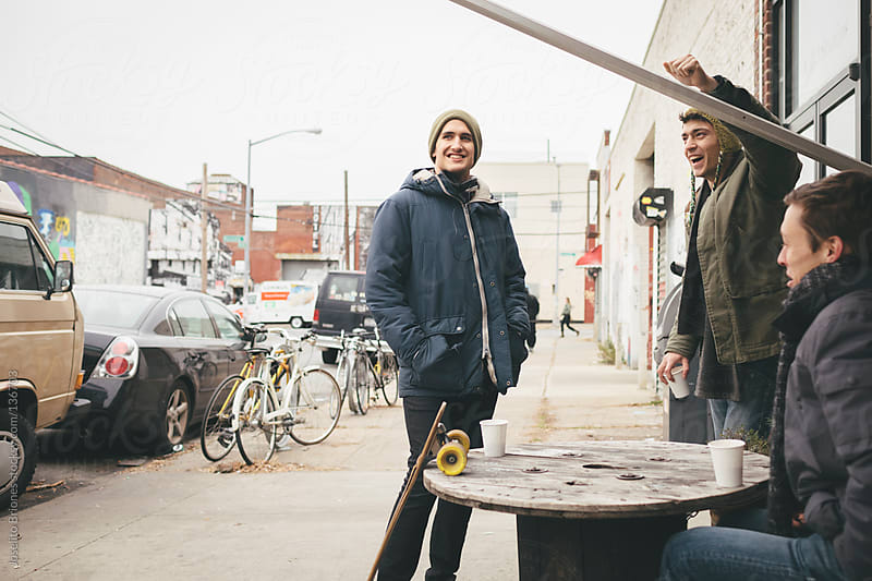 Relaxed Young Men Hanging Out and Chatting in East Williamsburg, Brooklyn by Joselito Briones for Stocksy United