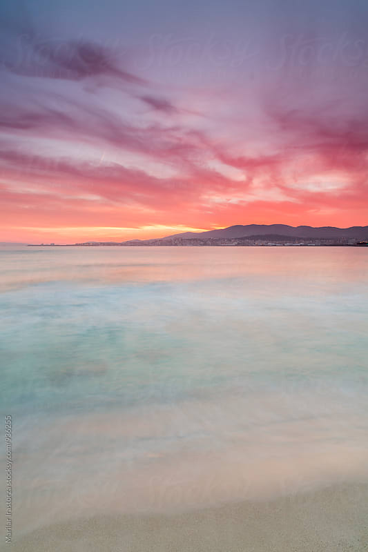 Beautiful sunset on the beach of Palma de Mallorca by Marilar Irastorza for Stocksy United