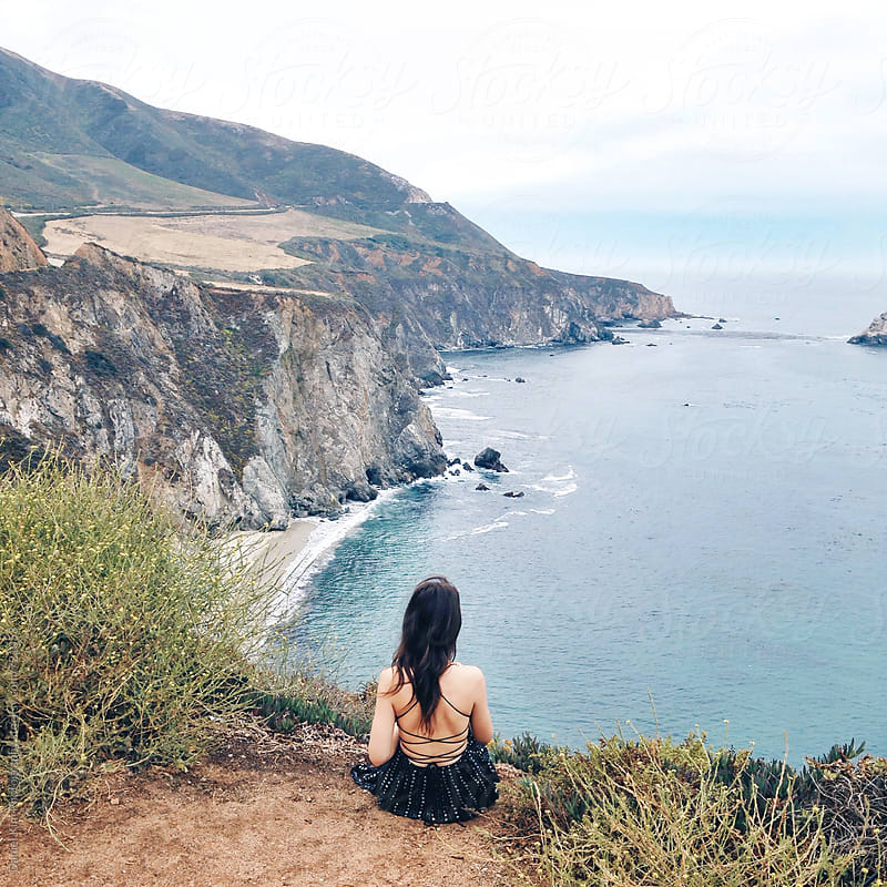 Woman taking in coastal views by Daniel Kim Photography for Stocksy United