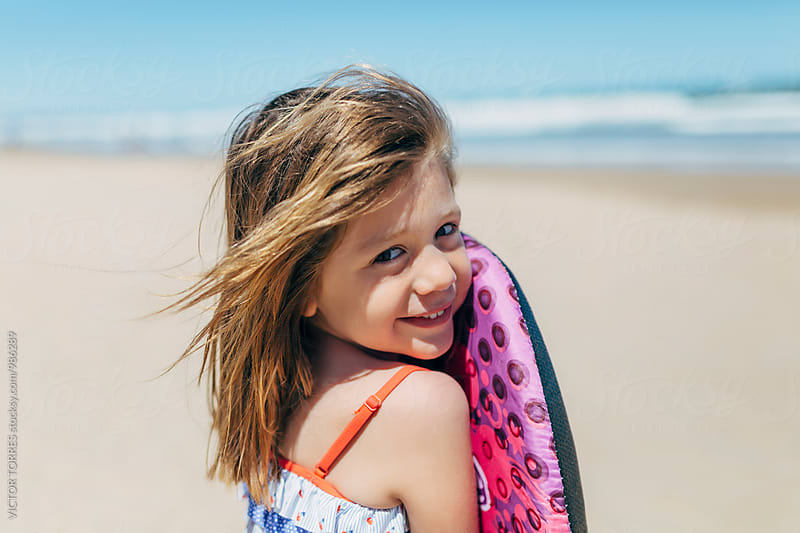 Portrait of an Adorable Little Girl at Beach by Victor Torres for Stocksy United