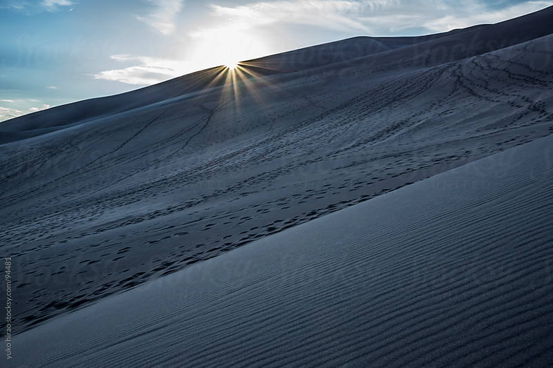 Dramatic sunset over sand dunes at desert by yuko hirao for Stocksy United