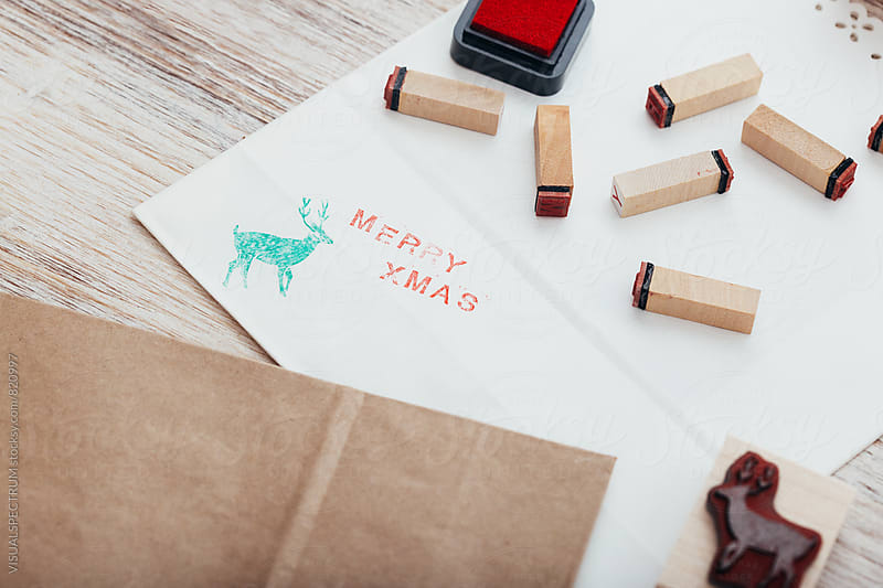 DIY Christmas - Close Up of Merry Xmas Written on White Paper With Stamped Letters by Julien L. Balmer for Stocksy United