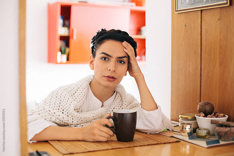 Woman drinking a coffee in the kitchen by Marija Mandic for Stocksy United
