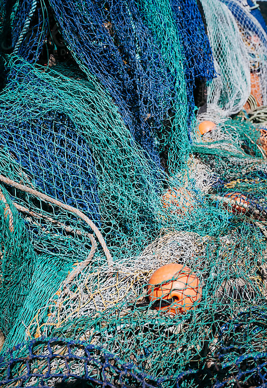 Fishing nets in the Harbour at Lyme Regis. Devon, UK. by Liam Grant for Stocksy United