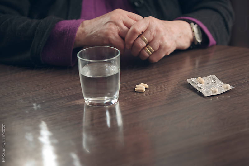 Ederly Woman taking medication by HEX. for Stocksy United