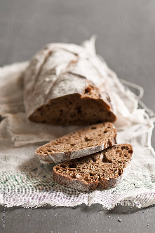 loaf of bread with wholemeal flour  by Laura Adani for Stocksy United