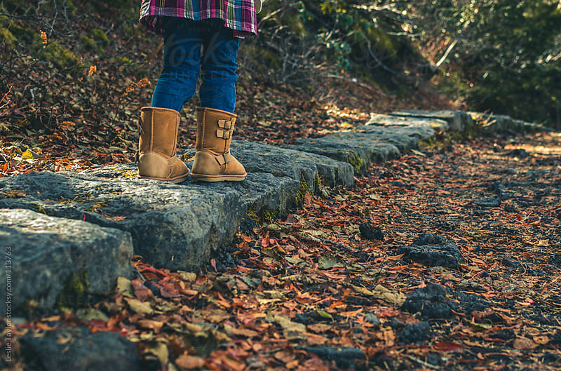 Child Walking On Stone Path In Autumn by Leslie Taylor for Stocksy United