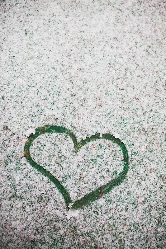 Heart drawn in a snow by Jovana Rikalo for Stocksy United