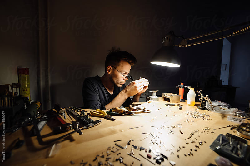 A young jeweller working at his desk by Tõnu Tunnel for Stocksy United