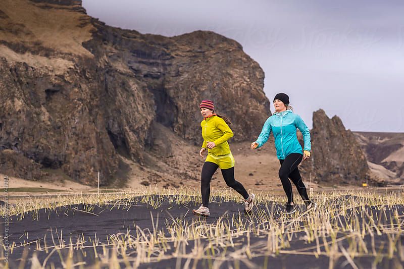 Two female runners in training by Søren Egeberg Photography for Stocksy United