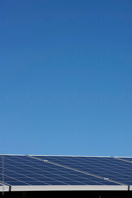 Solar Panels and Blue Sky by Adrian Young for Stocksy United
