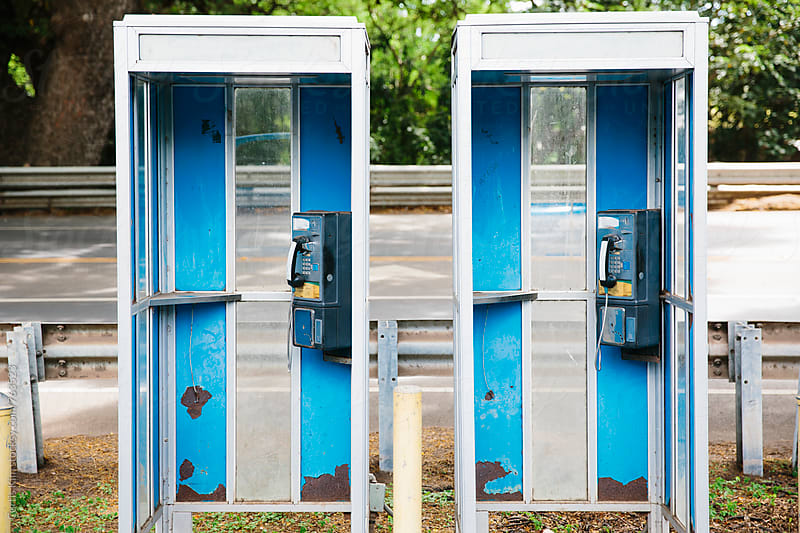 Old telephone booths still in operation by Curtis Kim for Stocksy United