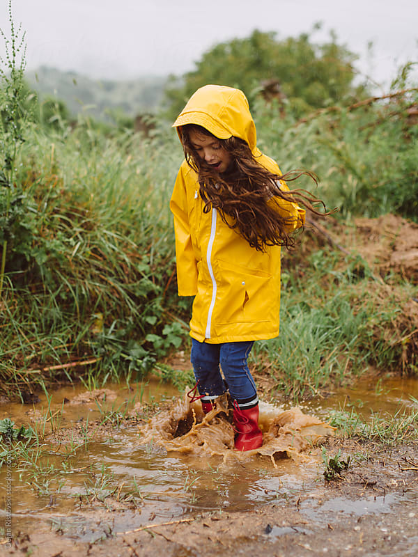 Playtime in the puddle. by Dejan Ristovski for Stocksy United