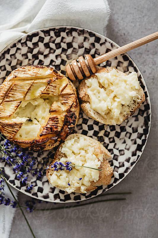 Baked camembert with honey and lavender by Tatjana Zlatkovic for Stocksy United