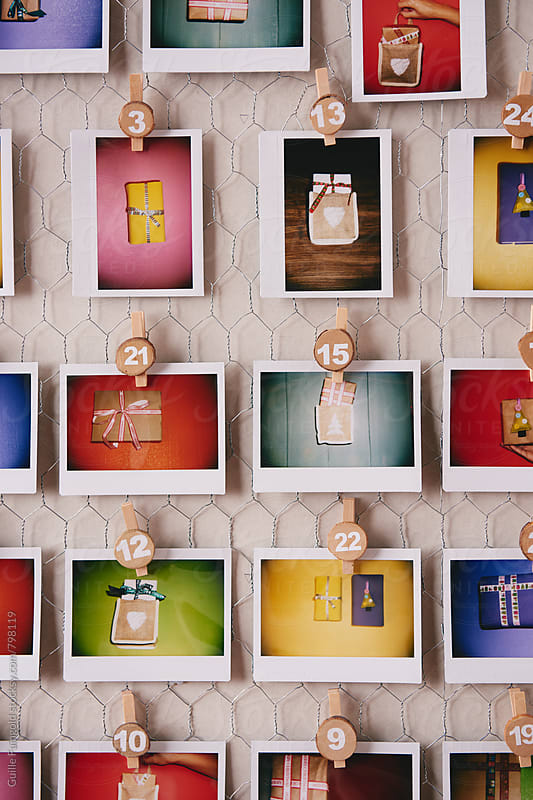 Handmade advent calendar with gift polaroids by Guille Faingold for Stocksy United