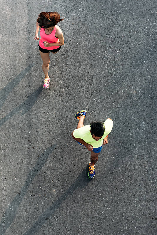 Young man and woman running by Maa Hoo for Stocksy United