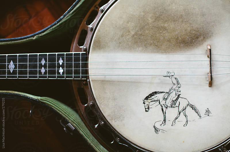 vintage banjo with hand drawn image, sitting in case by Lisa MacIntosh for Stocksy United