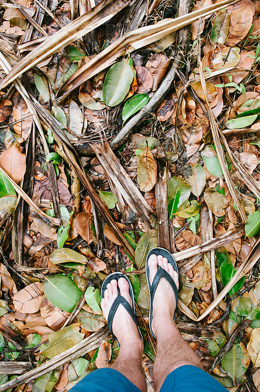 Feet, flip flops and leaves, Samoa. by Thomas Pickard for Stocksy United